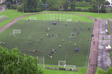 Sports field in summer and players on the sports field.