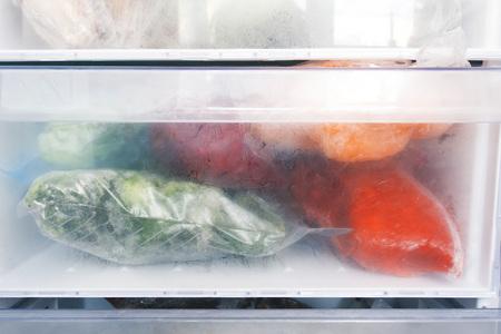 Freezer refrigerator with various frozen foods Stok Fotoğraf
