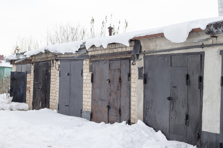 Garage complex in winter in cloudy weather.