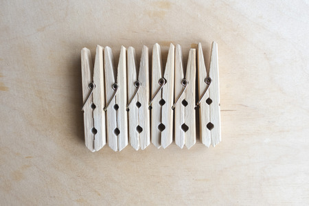 Wooden clothespins on wooden background