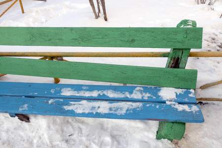 Old wooden bench in winter, close-up, snow. 版權商用圖片