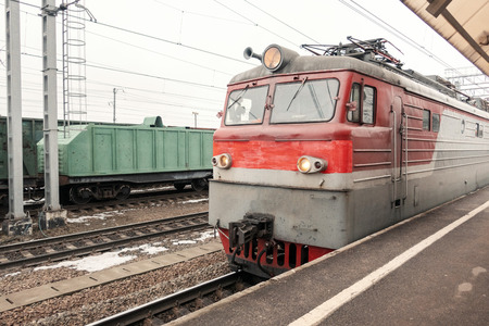 Train at the station in winter, close-up