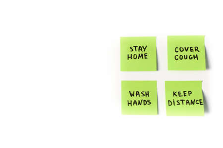 4 official precautions and preventive measures to follow on sticky post notes isolated on white background: stay home, wash hands, cover cough and keep distance in global coronavirus covid-19 pandemic