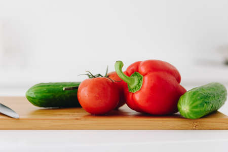 Close up of veggies: bell pepper, tomatoes and cucumbers, fresh and organic
