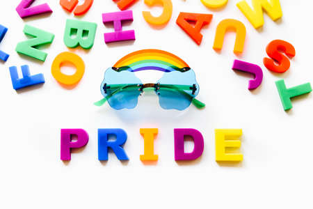 Gay love rainbow pride word isolated on white background. Equal rights, lqbtq pride month against gay, lesbian, bisexual, transgender discrimination.