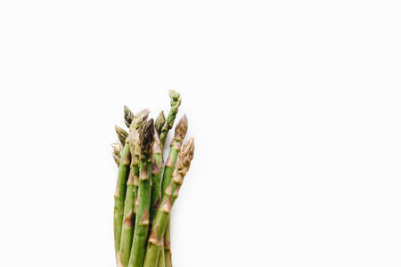 Bunch of fresh organic asparagus from farmers market isolated on white background, healthy vegetables and source of fibre and folate