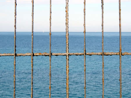 rusty fence: Rusty fence in front of the sea. Conceptual photo. Sunny summer day, Italy, Sicily