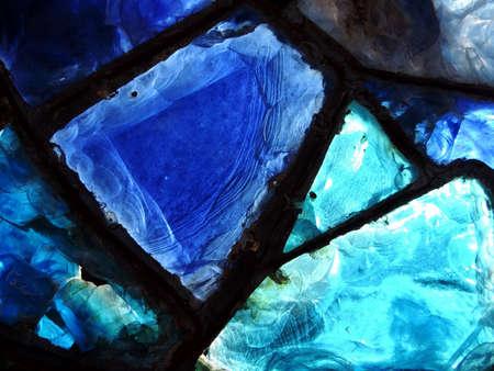 glasswork: Fragment of broken blue stained-glass window. Macro photo