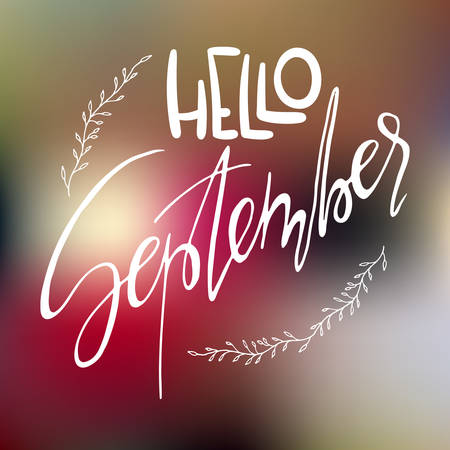 Decorative card with handdrawn lettering. White handlettering with floral frame on blurred colorful background. Trendy handwritten modern ink calligraphy. Hello September - Months collection - vector