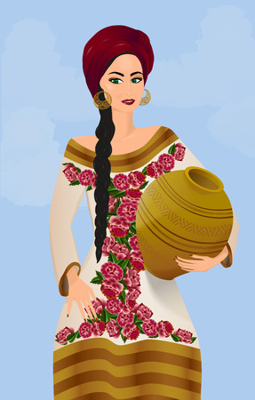 Beautiful girl in traditional ethnic traditional dress holding a jug