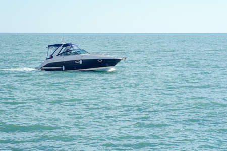 Pleasure boat on the sea.  Beautiful background 免版税图像