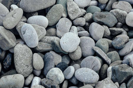 Gray stones close-up. Minimalistic beautiful background in gray tones. Pebble beach. 免版税图像