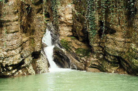 Cascade of a mountain river. Turquoise water. Beautiful background.