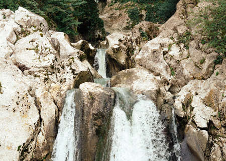 Waterfall in a mountain forest. Beautiful background 免版税图像