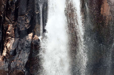 Close-up of a waterfall. Cinnamon tones.  Beautiful background