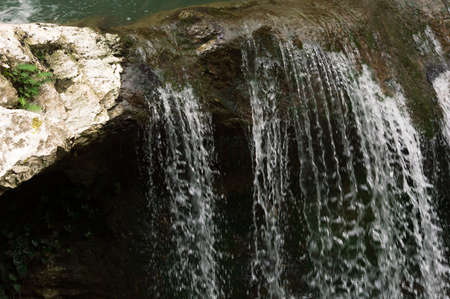 Beautiful background with splashes of the waterfall. 免版税图像