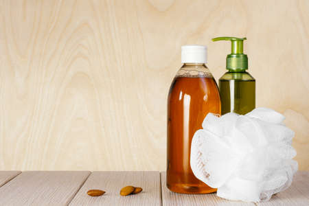 Composition with plastic bottles and washcloth for body care and beauty products 写真素材