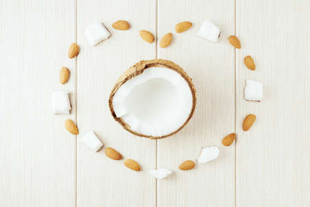 Composition with coconut and almonds. Beautiful background.
