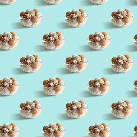 Seamless pattern with energy balls in a glass bowl on a turquoise background
