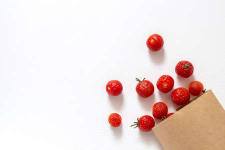 Ugly food. Wrinkled old cherry tomatoes on a white background. Horizontal orientation, top view. Stok Fotoğraf