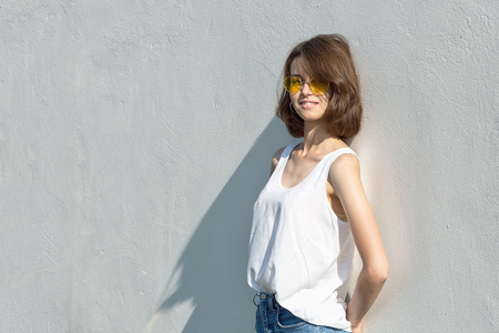 Portrait of a teenage girl in yellow glasses. Copy space.