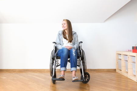 Handicapped woman sitting in wheelchair and smile. Reklamní fotografie