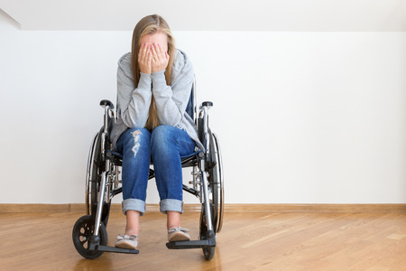 Depressed young woman on wheelchair. Hard invalid concept. Reklamní fotografie