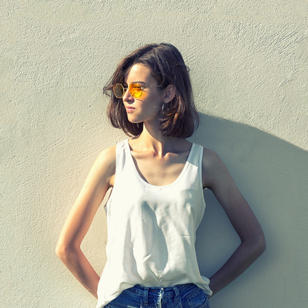 Portrait of a teenage  in yellow glasses.  .