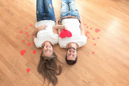 Top view of happy young couple with paper hearts. 写真素材