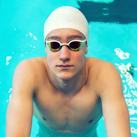 Portrait of a swimmer on the background of the pool. Pool background, copy space.