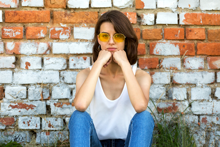 Serious Teenage girl in yellow glasses. Copy space.