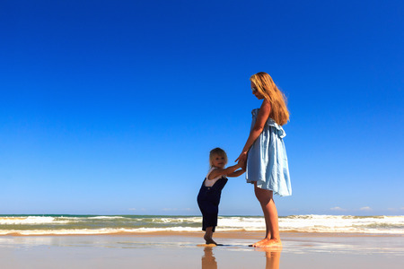 Happy Family! Mother and daughter stand on the beach. Copy space. Stockfoto