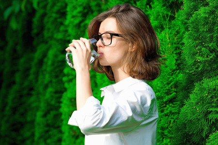 Young woman drinks water