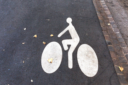 Bicycle sign painted on the road.