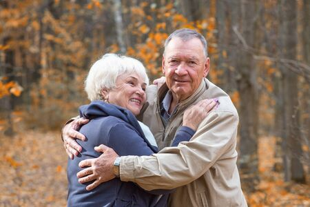 Portrait of happy senior couple hugging and smiling