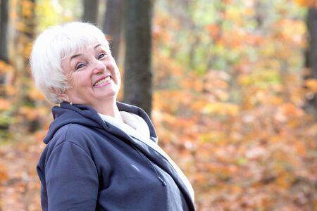 Portrait of beautiful senior woman in an autumn park Archivio Fotografico
