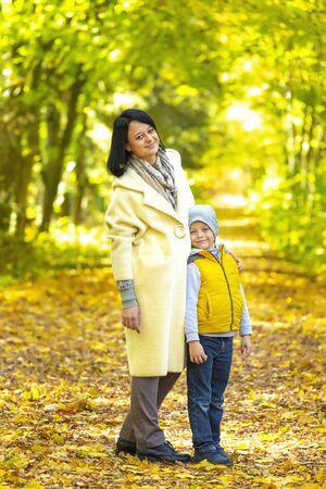 Happy Family! Mother and son have fun in autumn park Archivio Fotografico