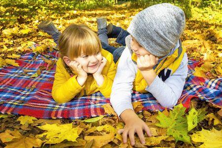 Two happy autumn children outdoors.  Archivio Fotografico