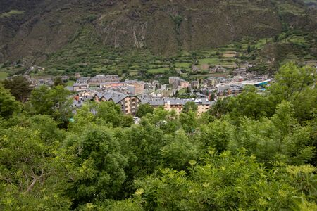Aerial view of a small village of Encamp, located in Pyrenees Mountains,in Andorra. Great place for hiking, trekking, camping. Great hike in the forest with lots of incredible views of the mountains Foto de archivo