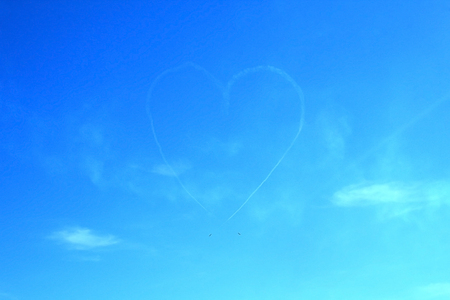 Heart drawn in a sky by two jet planes photo