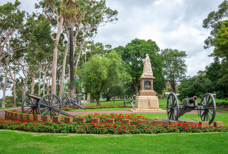 clouds: garden: A statue of Queen Victoria in Kings Park and Botanical Gardens in Perth Western Australia