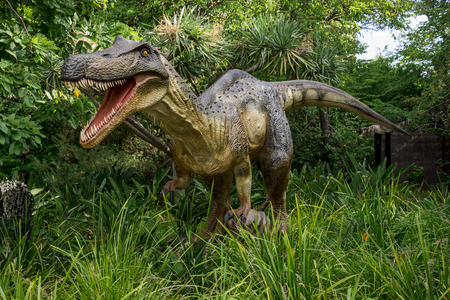carnivorous fish: Roaring Baryonyx standing in tall grass display model in Perth Zoo as part of Zoorassic exhibition