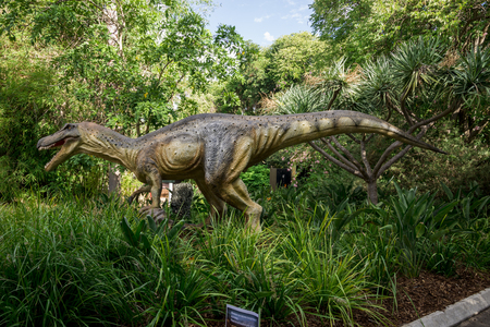 prehistoric fish: Baryonyx in tall grass display model in Perth Zoo as part of Zoorassic exhibition Stock Photo