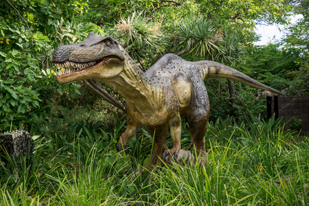 model fish: Baryonyx standing in tall grass display model in Perth Zoo as part of Zoorassic exhibition