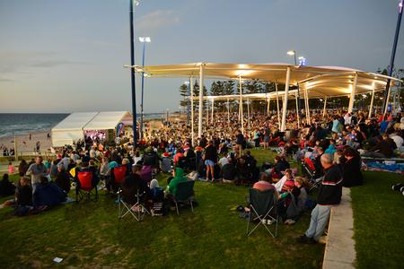 carols: Families enjoy picnics at Christmas Carols 2015 event on Scarborough Beach in Perth
