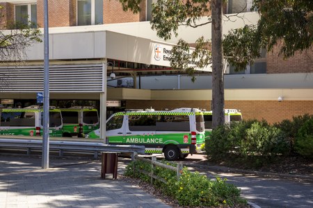 Ambulance vehicles parked at Emergency Department entrance, Royal Perth Hospital, Perth City, Western Australia