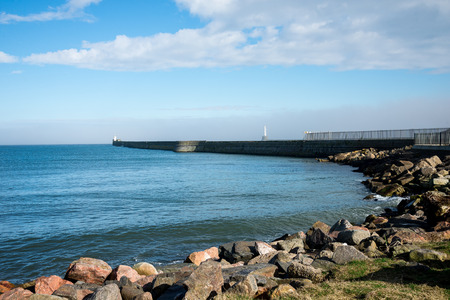 Lighthouses at piers in Aberdeen Harbour entrance Stock Photo