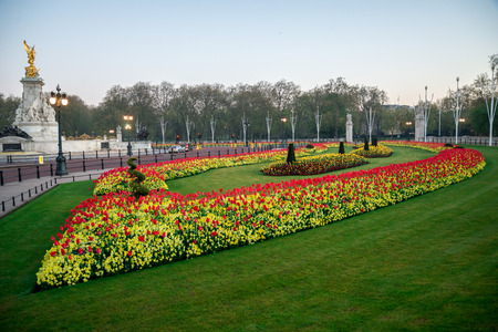 Flower-beds and Queen Victoria memorial near Buckingham Palace in London, England