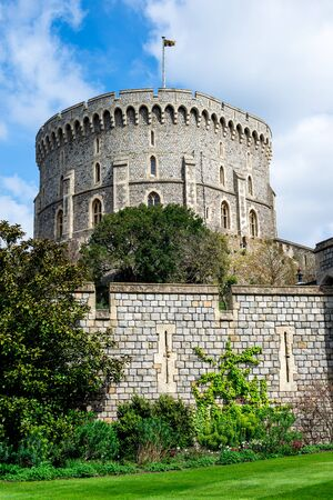 Round Tower with a raised flag in Windsor Castle, county of Berkshire, England