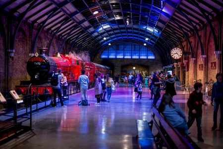 Visitors at platform 9 34 and Hogwarts Express in Warner Brothers Harry Potter Studio Tour, London Editorial